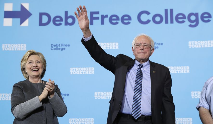 Democratic presidential candidate Hillary Clinton and Sen. Bernie Sanders, I-Vt. acknowledge the audience at a campaign stop at the University Of New Hampshire in Durham, N.H., Wednesday, Sept. 28, 2016. (AP Photo/Matt Rourke) ** FILE **