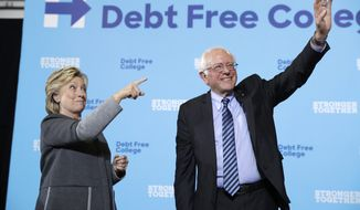 Democratic presidential candidate Hillary Clinton and Sen. Bernie Sanders, I-Vt. acknowledge the audience at a campaign stop at the University Of New Hampshire in Durham, N.H., Wednesday, Sept. 28, 2016. (AP Photo/Matt Rourke)