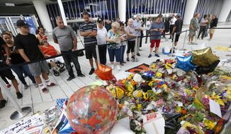Fans gather around a memorial for Miami Marlins pitcher Jose Fernandez outside Marlins Park stadium, Wednesday, Sept. 28, 2016, in Miami. Fernandez was killed in a weekend boating crash along with two friends. (AP Photo/Wilfredo Lee)