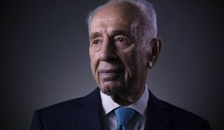 FILE - In this Monday, Feb. 8, 2016  file photo, Israel's former President Shimon Peres poses for a portrait at the Peres Center for Peace in Jaffa, Israel. Israel's Foreign Ministry says a long list of world leaders will attend Shimon Peres' funeral on Friday. Spokesman Emmanuel Nahshon said Wednesday that President Obama, Bill and Hillary Clinton, Pope Francis, Prince Charles and Canadian Prime Minister Justin Trudeau are all expected. (AP Photo/Oded Balilty, File)