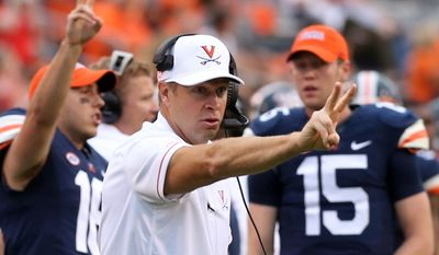 FILE - In this Sept. 3, 2016, file photo, Virginia head coach Bronco Mendenhall calls for a two-point conversion during the second half of an NCAA college football game in Charlottesville, Va. (AP Photo/Andrew Shurtleff, File) **FILE**