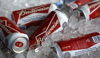 In this Thursday, March 5, 2015, file photo, Budweiser beer cans are on ice at a concession stand at McKechnie Field in Bradenton, Fla. (AP Photo/Gene J. Puskar, File)