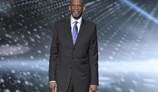 "FILE - In this July 13, 2016, file photo, Kareem Abdul-Jabbar presents a tribute to Muhammad Ali at the ESPY Awards at the Microsoft Theater in Los Angeles. Abdul-Jabbar's next book will be a fond look back at his long friendship with John Wooden, the celebrated basketball coach at UCLA. ""Coach Wooden and Me"" will be published next June and will combine personal memories and lessons learned from his friend and mentor, Grand Central Publishing told The Associated Press on Wednesday, Sept. 28. (Photo by Chris Pizzello/Invision/AP, File)"