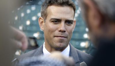 FILE - In this Monday, April 11, 2016 file photo, Chicago Cubs president Theo Epstein talks to media at Wrigley Field before the start of an opening day baseball game between the Cincinnati Reds and the Chicago Cubs in Chicago. The Chicago Cubs have agreed to a five-year contract extension with president of baseball operations Theo Epstein on Wednesday, Sept. 28, 2016 rewarding him for an overhaul that has a long-suffering franchise eyeing its first championship since 1908. The agreement announced Wednesday keeps Epstein under contract through 2021. (AP Photo/Nam Y. Huh, File)