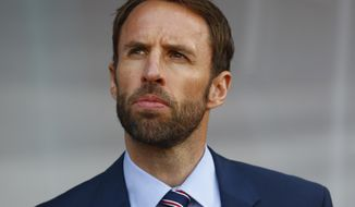 FILE - In this June 21, 2015 file photo, England's coach Gareth Southgate arrives for the Euro U21 soccer championship group B match between Sweden and England, at the Ander stadium in Olomouc, Czech Republic. Gareth Southgate, the manager of England's under-21 side, will take charge of the senior team's next four matches, against Malta, Slovenia, Scotland and Spain, while the FA searches for a new coach. (AP Photo/Matthias Schrader, file)