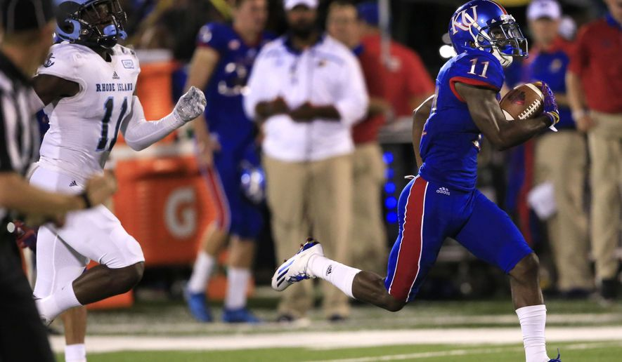 FILE - In this Sept. 3, 2016, file photo, Kansas wide receiver Steven Sims Jr. (11) runs for a touchdown past Rhode Island defensive back D.J. Stewart (11) during the second half of an NCAA college football game in Lawrence, Kan. Simes, a sophomore from Houston, has four TDs and 253 yards on 11 catches. Kansas takes on Texas Tech on Thursday. (AP Photo/Orlin Wagner, File)