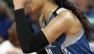 Minnesota Lynx's Maya Moore cheers her team on during a break on the bench in the second half of a WNBA playoff semi-finals basketball game against the Phoenix Mercury Wednesday, Sept. 28, 2016, in St. Paul, Minn. Moore led the Lynx with 31 points in their 113-95 win. (AP Photo/Jim Mone)