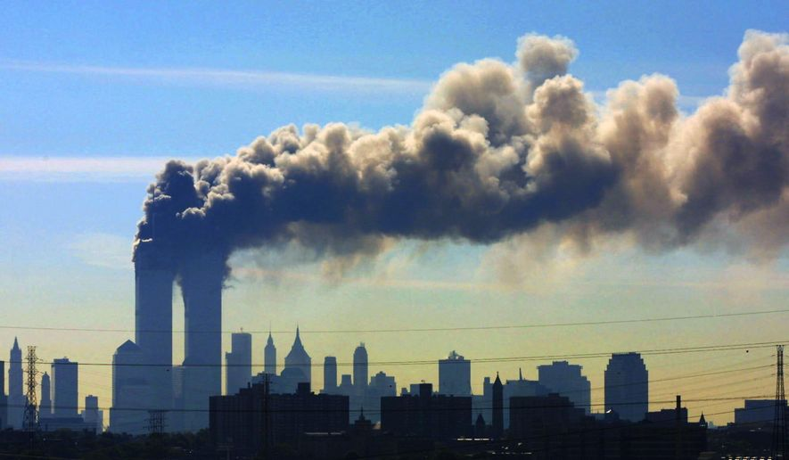 Smoke billows from the twin towers of the World Trade Center in New York after airplanes crashed into both towers, Sept. 11, 2001. (AP Photo/Gene Boyars) ** FILE **