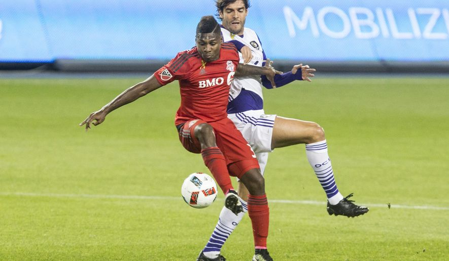 Toronto FC's Amando Cooper, left, battles for the ball with Orlando City's Kaka during the first half of a soccer game, Wednesday, Sept. 28, 2016 in Toronto. (Chris Young/The Canadian Press via AP)