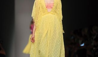 A model wears a creation for Rochas Spring-Summer 2017 Ready-to-Wear fashion collection as part of Paris Fashion week, Wednesday, Sept. 28, 2016 in Paris. (AP Photo/Thibault Camus)