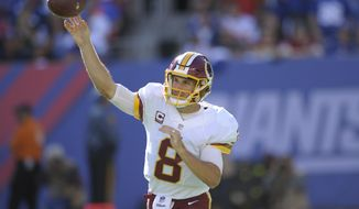 In this photo taken Sept. 25, 2016, Washington Redskins quarterback Kirk Cousins (8) throws a pass during the second half of an NFL football game against the New York Giants in East Rutherford, N.J. A year after so much success in the red zone, Kirk Cousins and the Washington Redskins are about as bad as it gets in the NFL from inside the 20 right now. Heading into the Sunday, Oct. 2, 2016, game against the visiting Cleveland Browns, the Redskins (1-2) rank 31st out of 32 teams in turning red-zone possessions into touchdowns, going just 3 for 14 so far, a success rate of 21 percent. (AP Photo/Bill Kostroun)
