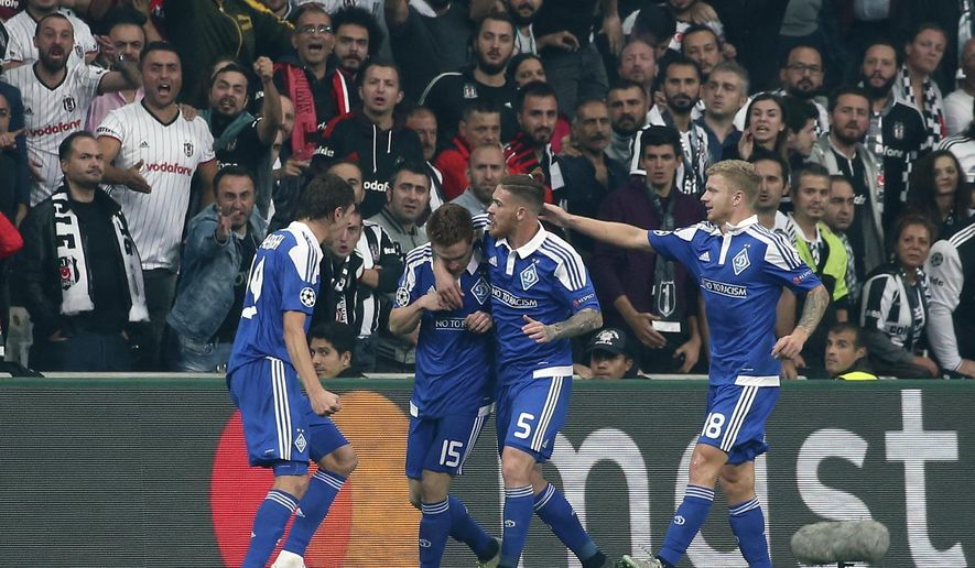 Dynamo Kiev's Viktor Tsygankov, second left, celebrates with his teammates after he scored against Besiktas during their Champions League group B soccer match in Istanbul, Wednesday, Sept. 28, 2016. (AP Photo)