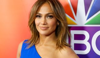 "In this Jan. 13, 2016, file photo, Jennifer Lopez arrives at the 2016 NBCUniversal Winter TCA in Pasadena Calif. NBC announced on Oct. 27 that Ms. Lopez will star in a December 2017 live musical production of ""Bye Bye Birdie"" (Photo by Rich Fury/Invision/AP, File) **FILE**"