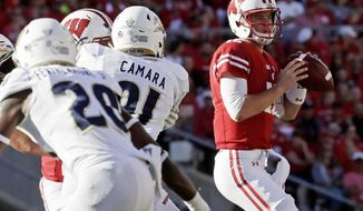 FILE - In this Sept. 10, 2016, file photo, Wisconsin quarterback Alex Hornibrook drops back to pass during the second half of an NCAA college football game against Akron in Madison, Wis. One start into his college career and has already proven that he can handle big-game pressure. The stakes are only going to get higher this weekend at No. 4 Michigan. (AP Photo/Morry Gash, File)