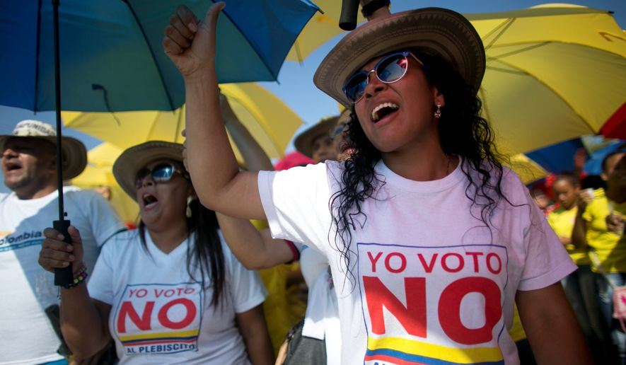 "Demonstrators yell, ""No to the plebiscite,"" to protest the government's peace agreement with the Revolutionary Armed Forces of Colombia, which has been involved in a half-century of warfare that has caused more than 200,000 casualties. (Associated Press)"