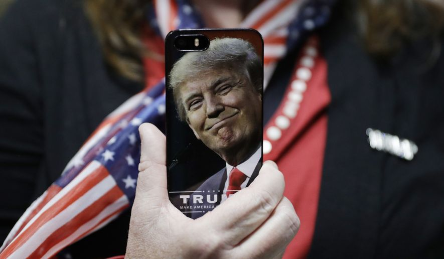 A woman holds up her cell phone before a rally with Republican presidential candidate Donald Trump, Thursday, Sept. 29, 2016, in Bedford, N.H. (AP Photo/John Locher) ** FILE **