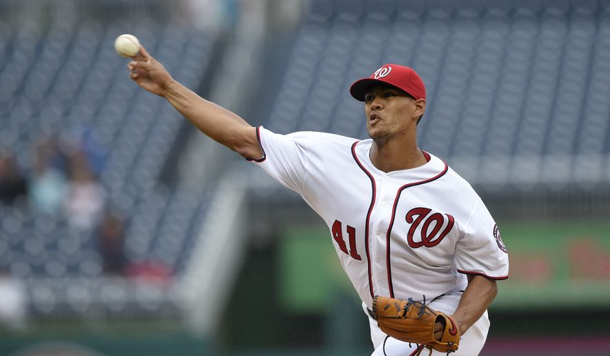Washington Nationals starting pitcher Joe Ross delivers a pitch during a baseball game against the Arizona Diamondbacks, Thursday, Sept. 29, 2016, in Washington. (AP Photo/Nick Wass)