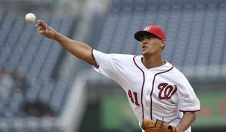 Washington Nationals starting pitcher Joe Ross delivers a pitch during the first inning of a baseball game against the Arizona Diamondbacks, Thursday, Sept. 29, 2016, in Washington. (AP Photo/Nick Wass)