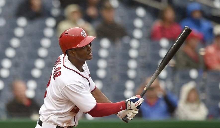 Washington Nationals' Michael Taylor follows through on his double during the eighth inning of a baseball game against the Arizona Diamondbacks, Thursday, Sept. 29, 2016, in Washington. (AP Photo/Nick Wass)