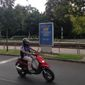 """In this Aug. 13, 2016, file picture a person on motorbike passes a government poster promoting the Oct. 2 referendum against any EU quotas to resettle migrants. reading """"Did you know?"""" Hungarians will vote Sunday in a referendum called by Prime Minister Viktor Orbans government, seeking political support against any future plans by the European Union to resettle refugees or asylum seekers among members of the bloc. (AP Photo/ Pablo Gorondi, file)"""