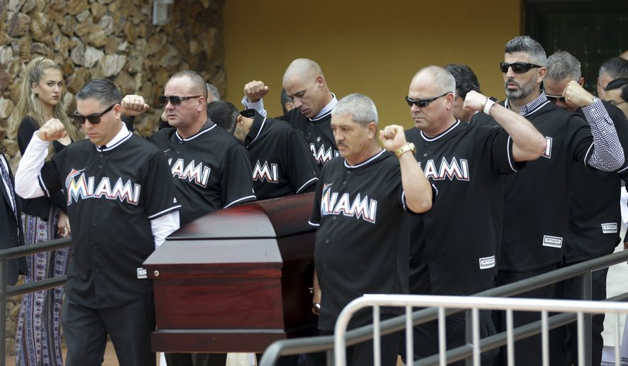 Pallbearers wearing Miami Marlins jerseys carry the casket of Miami Marlins pitcher Jose Fernandez, after a memorial service at St. Brendan's Catholic Church, Thursday, Sept. 29, 2016, in Miami. Fernandez was killed in a boating accident Sunday along with two friends. (AP Photo/Lynne Sladky)