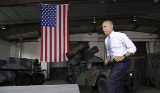 President Barack Obama quickly takes the steps to the stage to speak to members of the military community, Wednesday, Sept. 28, 2016, in Fort Lee, Va. (AP Photo/Carolyn Kaster) ** FILE **
