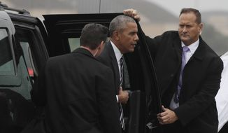President Barack Obama steps from his motorcade vehicle to board Air Force One, Thursday, Sept. 29, 2016, at Andrews Air Force Base, Md., en route to the funeral of former Israeli President Shimon Peres in Jerusalem. (AP Photo/Carolyn Kaster)