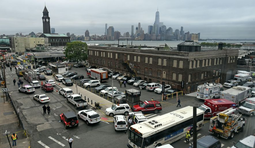 The skyline of New York's borough of Manhattan is seen behind the Hoboken, N.J. rail station after a train crash at the facility on Thursday, Sept. 29, 2016. A commuter train plowed into the bustling terminal during the morning rush hour. (AP Photo/Joe Epstein)