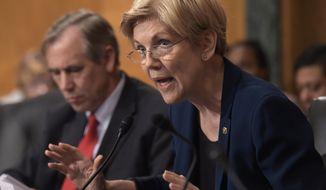 In this Sept. 20,2016 file photo, Sen. Elizabeth Warren, D-Mass. speaks on Capitol Hill in Washington.  (AP Photo/Susan Walsh, File) **FILE**