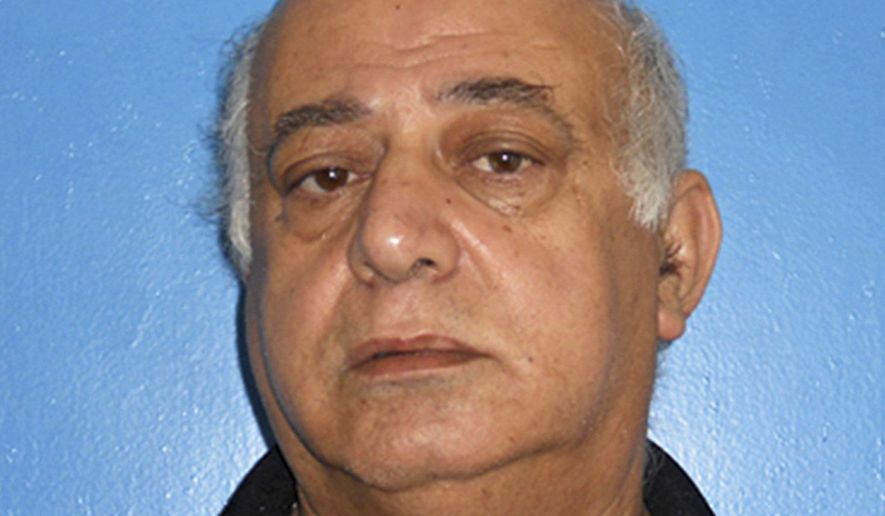 This September 2016 booking photo provided by the Rocky River, Ohio, Division of Police shows Jamal T. Mansour in Rocky River, Ohio. Jamal T. Mansour, charged with murder in the fatal shooting of his adult daughter Tahani Mansour at their suburban Cleveland home, had his bond increased Thursday, Sept. 29, 2016 to $4.5 million by a judge after a prosecutor said the man was a flight risk. (Rocky River, Ohio, Division of Police via AP)