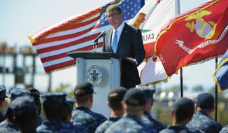 "Secretary of Defense Ash Carter speaks to sailors on the flight deck of the USS Carl Vinson, Thursday, Sept. 29, 2016 at Naval Air Station, North Island in Coronado, Calif. Defense Secretary Ash Carter on Thursday said the U.S. will ""sharpen our military edge"" in Asia and the Pacific in order to remain a dominant power in a region feeling the effects of China's rising military might. Carter made the pledge in a speech aboard the aircraft carrier USS Carl Vinson in port in San Diego. (Nelvin C. Cepeda/The San Diego Union-Tribune via AP)"