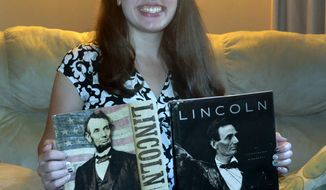 In this Sept. 20, 2016 photo, Michaela Wieties, poses in her home in Racine, Wis. Wieties, a Union Grove High School senior was one of three students from across the country to win a scholarship to the prestigious Lincoln Forum Symposium in Gettysburg, Pa., in November. Wieties has loved Lincoln and Civil War history for years. (Mark Feldmann/The Journal Times via AP)