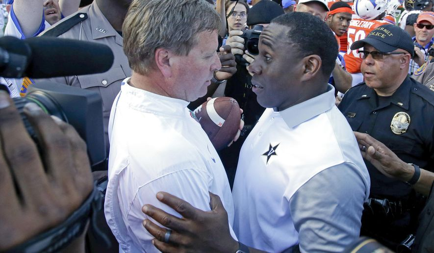 FILE - In this Nov. 7, 2015, file photo, Florida head coach Jim McElwain, left, greets Vanderbilt head coach Derek Mason, right, after Florida won 9-7 in an NCAA college football game in Gainesville, Fla. The Gators have an opportunity Saturday to prove they can shake off not just one, but two ugly hangovers. The 23rd-ranked Gators make their second consecutive trip to the Tennessee to play Vanderbilt on Saturday, a week after blowing a 21-point lead in being routed 38-28 by the Tennessee Volunteers.  (AP Photo/John Raoux, File)