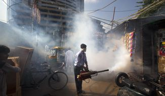 In this Friday, Sept. 2, 2016 photo, a municipal worker fumigates an area to check the spread of mosquito-borne diseases in New Delhi, India. This year the Indian capital has seen the numbers for Chikungunya soar to more than 3,000 from just 64 last year, according to government data. Each year the city seems equally unprepared for the epidemic of Dengue and Chikungunya, viral ailments transmitted by mosquitoes, that arrives promptly in August and lingers for months sickening tens of thousands and killing dozens. It's a cycle that's played out every year after the monsoon rains have filled puddles and open drains and the warm, damp weather is perfectly suited for swarms of mosquitoes. (AP Photo/Manish Swarup)