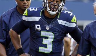 FILE - In this Sunday, Sept. 25, 2016, file photo,Seattle Seahawks quarterback Russell Wilson walks off the field after being brought down against the San Francisco 49ers in the second half of an NFL football game Seattle. Despite spraining the medial collateral ligament in his left knee last Sunday against San Francisco, Seattle quarterback Russell Wilson is expected to start against the New York Jets. (AP Photo/Ted S. Warren, File)