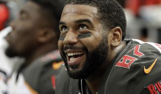"FILE - In this Sept. 11, 2016, file photo, Tampa Bay Buccaneers tight end Austin Seferian-Jenkins smiles on the sidelines during the second half of an NFL football game against the Atlanta Falcons in Atlanta. Seferian-Jenkins is thankful for a ""once-in-a-lifetime"" opportunity with the New York Jets, who gave the tight end a chance to resume his career after he was released by the Tampa Bay Buccaneers following a DUI arrest last weekend. Claimed off waivers by the Jets on Monday, he participated in his first practice with the team Thursday. It's uncertain if he'll play against Seattle on Sunday. (AP Photo/David Goldman, File)"