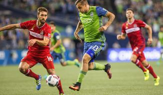 Seattle Sounders' Jordan Morris presses an attack during the first half against the Chicago Fire in an MLS soccer match Wednesday, Sept. 28, 2016, in Seattle. Fire's Jonathan Campbell is at left. (Dean Rutz/The Seattle Times via AP)