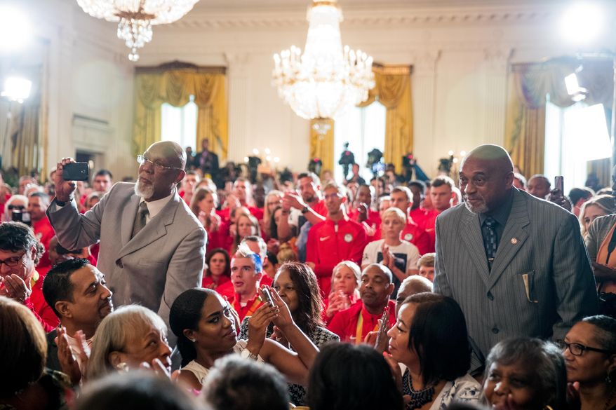 "1968 US Olympic athletes Tommie Smith, right, and John Carlos, left, stand as they are recognized by President Barack Obama during a ceremony in the East Room of the White House in Washington, Thursday, Sept. 29, 2016, where the president honored the 2016 United States Summer Olympic and Paralympic Teams. Smith and Carlos extended their gloved hands skyward in racial protest during the playing of ""The Star-Spangled Banner"" after Smith received the gold and Carlos the bronze medal in the 200 meter run at the Summer Olympic Games in Mexico City 1968. (AP Photo/Andrew Harnik)"