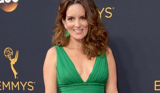 FILE - In this Sept. 18, 2016 file photo, Tina Fey arrives at the 68th Primetime Emmy Awards in Los Angeles. The actress will receive the Lew Klein Alumni in the Media Award from Temple University at a luncheon on Oct. 7. Fey isn't a Temple alumna, but her late father studied journalism there and graduated in 1966. (Photo by Richard Shotwell/Invision/AP, File)