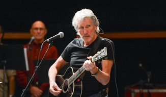 In this Nov. 4, 2013, file photo, musician Roger Waters and his band hold rehearsals with members of the Wounded Warriors Project, in New York. (Photo by Evan Agostini/Invision/AP, File)