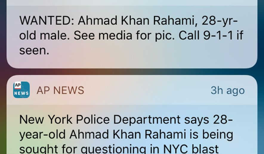 FILE - This file frame grab from a cellphone shows an emergency alert along with a news alert on Monday, Sept. 19, 2016, about a man wanted in connection with explosions in the New York City metropolitan area. The federal government is beefing up emergency cellphone alerts like the one used in New York to advertise the search for the bombing suspect. The Federal Communications Commission approved a measure Thursday, Sept. 29, 2016, that will let messages be up to four times longer than the current 90-character limit, and cellphone companies will have to support Spanish messages under the new rules. The changes will also let officials target messages more narrowly and include links in messages. (AP Photo/File)