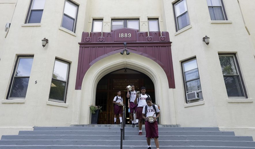 In this Thursday, Sept. 8, 2016 photo, a cadets walk out of the academic building at the New York Military Academy in Cornwall-on-Hudson, N.Y. While Republican presidential nominee, Donald Trump, talks tough about dealing with China, his old military prep school is building bridges to that country. The New York Military Academy began classes this fall with new Chinese backing and a former New York City high school principal originally from China in charge. (AP Photo/Mike Groll)
