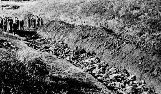 FILE - This a 1944 file photo of  part of the Babi Yar ravine at the outskirts of Kiev, Ukraine where the advancing Red Army unearthed the bodies of 14,000 civilians killed by fleeing Nazis, 1944. Ukrainians have marked the 75th anniversary of the Babi Yar massacre, one of the most infamous mass slaughters of World War II. (AP Photo, file)
