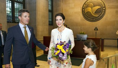 """FILE - In this Wednesday, Sept. 28, 2016 file photo, Crown Prince Frederik of Denmark and his wife Crown Princess Mary arrive at the U.S. Chamber of Commerce in Washington, for the opening of the U.S. Denmark Trade Mission. At right is Mia Heltberg, 7, who presented Princess Mary with flowers. Crown Prince Frederik and his wife Mary are kicking off a two-day trade mission to Boston. On Thursday, Sept. 29, Frederik is scheduled to join Democratic Boston Mayor Marty Walsh for an event at Boston University highlighting ways to promote urban sustainability and climate resilience, including ways to """"future-proof"""" cities. (AP Photo/Cliff Owen, File)"""