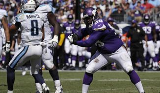 FILE - In this Sept. 11, 2016, file photo, Minnesota Vikings defensive tackle Linval Joseph (98) celebrates after sacking Tennessee Titans quarterback Marcus Mariota (8) for a 9-yard loss during the second half of an NFL football game in Nashville, Tenn. Joseph flourished last season as the chief run-stopper in the middle of Minnesota's defense. This year, Joseph has shown some pass-rushing prowess, too, from his nose tackle spot for the Vikings. (AP Photo/James Kenney, File)