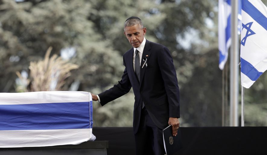 U.S. President Barack Obama touches the casket of former Israeli President Shimon Peres after speaking during a memorial service at Mount Herzl national cemetery in Jerusalem, Friday, Sept. 30, 2016. Peres died early Wednesday from complications from a stroke. He was 93. (AP Photo/Carolyn Kaster)