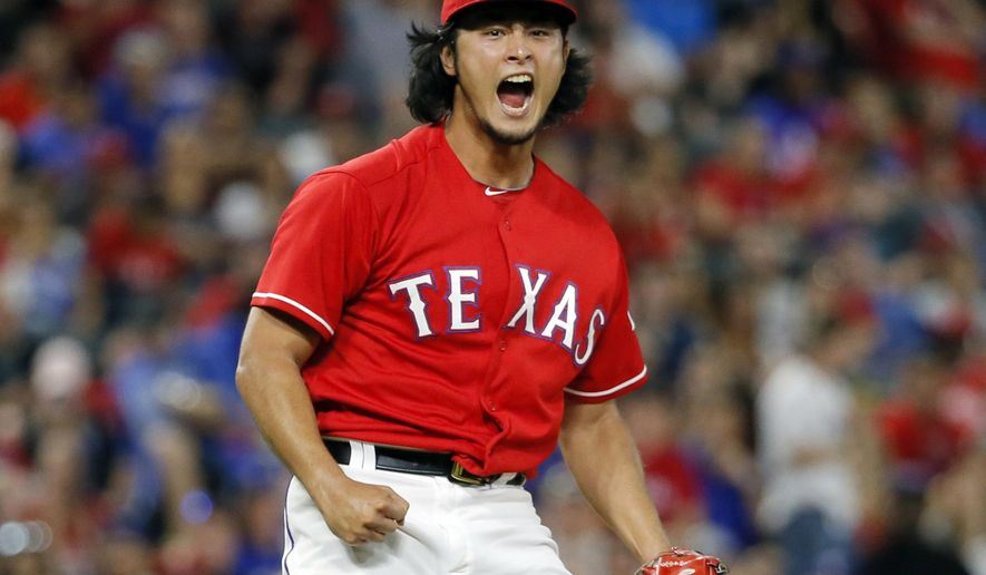 Texas Rangers starting pitcher Yu Darvish celebrates after getting Tampa Bay Rays' Jaff Decker to strike out to end the top of the sixth inning of a baseball game, Friday, Sept. 30, 2016, in Arlington, Texas. (AP Photo/Tony Gutierrez)