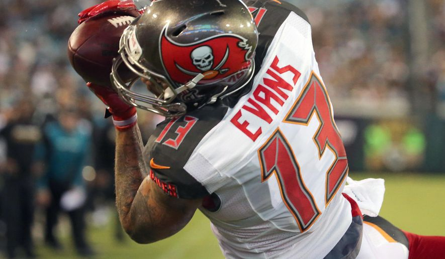 In this Aug. 20, 2016, file photo, Tampa Bay Buccaneers wide receiver Mike Evans catches a 4-yard pass for a touchdown against the Jacksonville Jaguars during the first half of an NFL preseason football game in Jacksonville, Fla. The Denver Broncos are impressed with Jameis Winston and Evans, a couple of rising young stars who are transforming the identity of the once-plodding Buccaneers. (AP Photo/Stephen B. Morton, File)