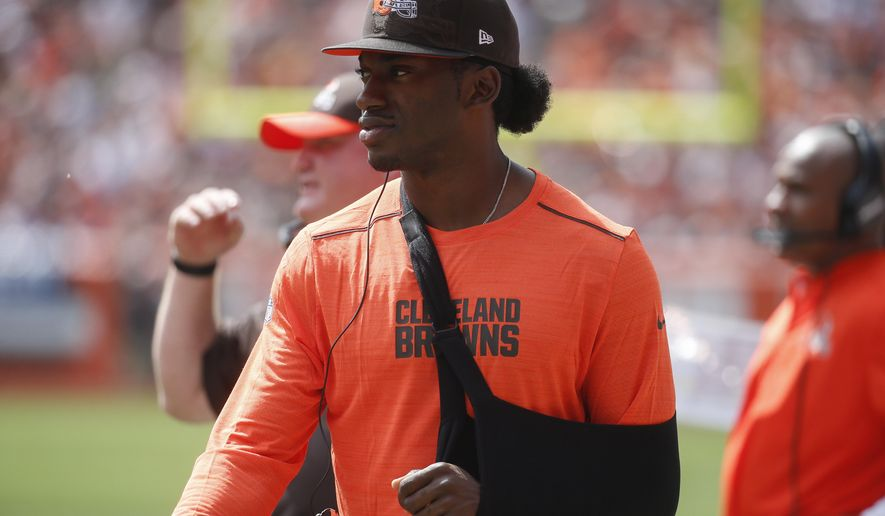 In this photo taken Sept. 18, 2016, Injured Cleveland Browns quarterback Robert Griffin III walks the sidelines in the first half of an NFL football game against the Baltimore Ravens, in Cleveland. When the NFL regular-season schedule came out, one opponent in particular stood out for the Washington Redskins: Robert Griffin III and the Cleveland Browns in Week 4. (AP Photo/Ron Schwane)
