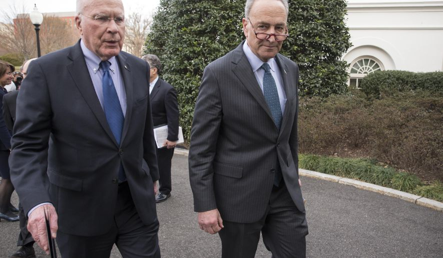 FILE - In this March 16, 2016 file photo, Sen. Patrick Leahy, D-Vt., the ranking member of the Senate Judiciary Committee, left, and Sen. Chuck Schumer, D-N.Y., right, depart the White House, in Washington. Schumer and Leahy said multiple states are violating federal law with their mail-in voter registration deadlines for the November election, blocking applications as many as three days earlier than other states and potentially disenfranchising thousands of people. In a letter this week, the pair have asked the U.S. Election Assistance Commission to intervene and work with election officials in nine states to ensure compliance with the National Voting Rights Act.   (AP Photo/J. Scott Applewhite, File)